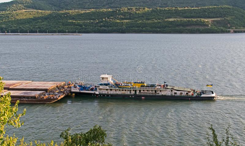 Drobeta Turnu Severin, Romania. August, 13, 2019- A ship pushes barges to shore on the Danube. The picture taken on the shore stock photo