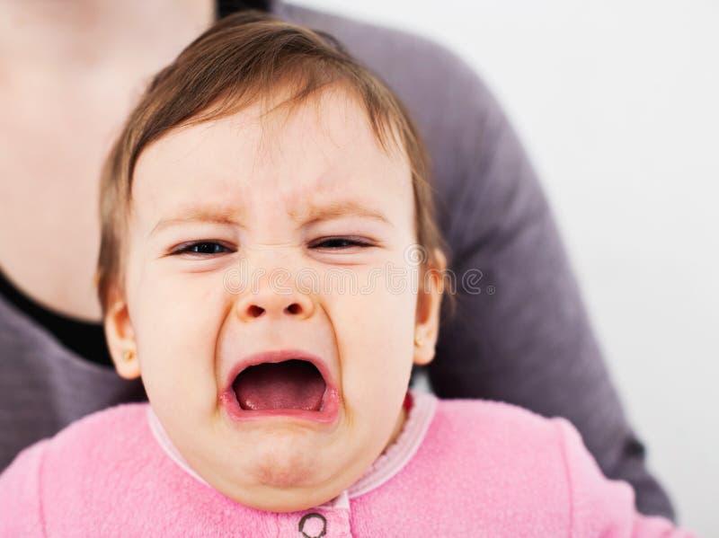 Droevig babymeisje stock afbeelding