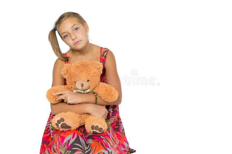 Droevig kind in kleding royalty-vrije stock afbeelding