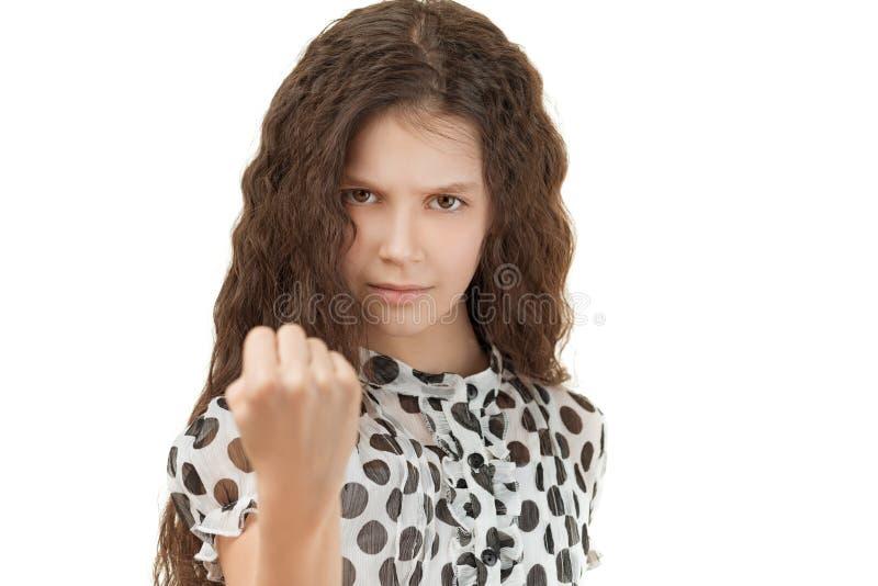 Droevig schoolmeisje die vuist bedreigen stock afbeeldingen