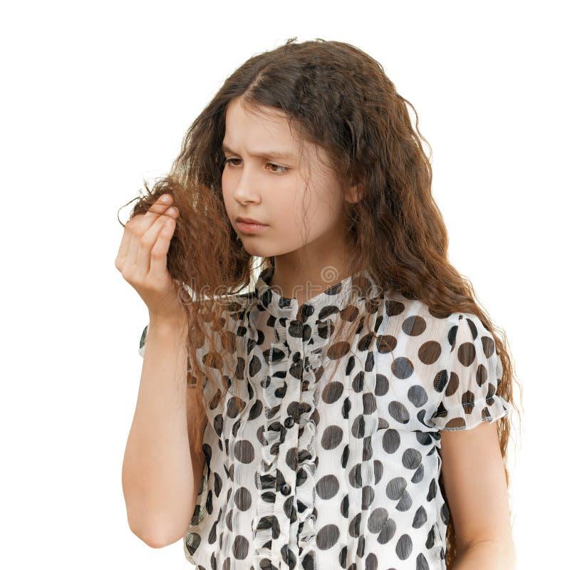 Droevig schoolmeisje ongelukkig met haar stock foto