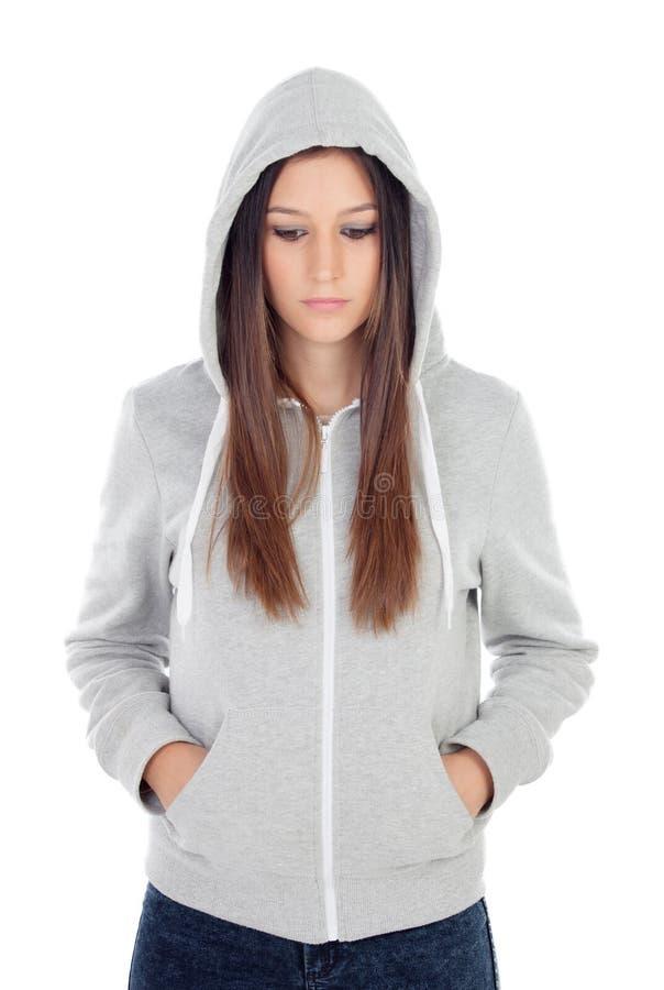 Droevig tienermeisje met grijs sweatshirt met een kap stock foto's