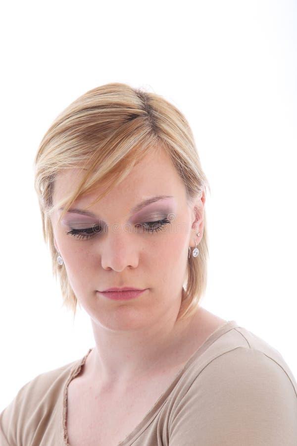 Droevige blonde vrouw royalty-vrije stock afbeeldingen