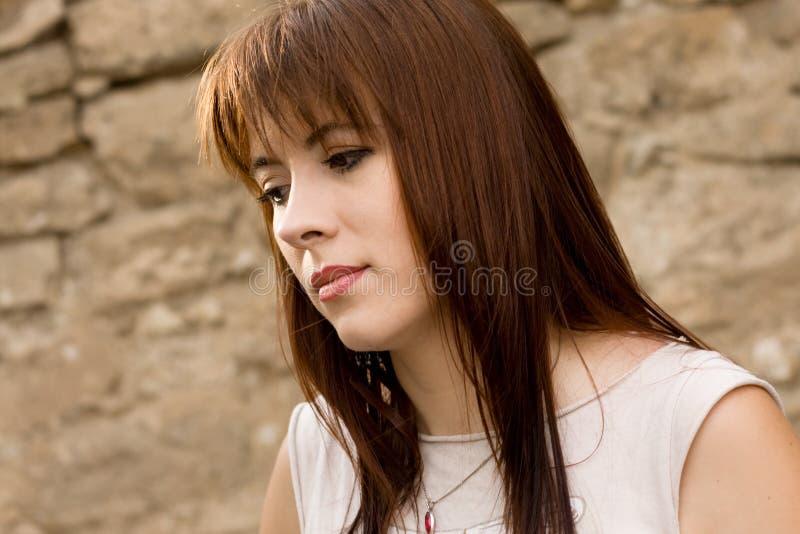 Droevige jonge vrouw royalty-vrije stock fotografie