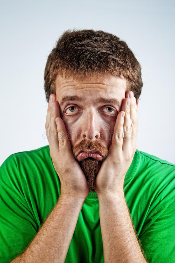 Droevige ongelukkige bored gedeprimeerde mens stock foto's