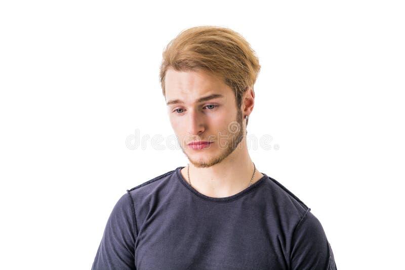 Droevige of ongerust gemaakte knappe jonge mens royalty-vrije stock foto