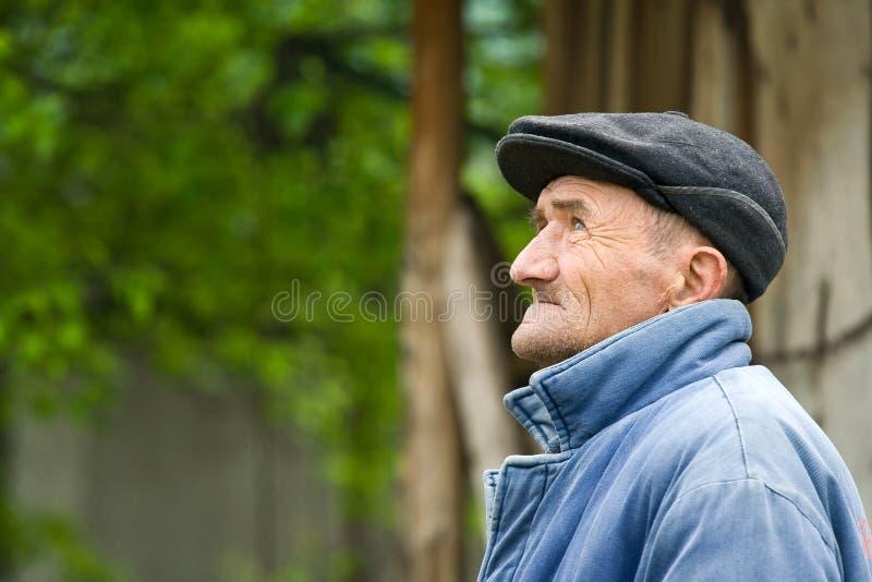 Droevige oude mens stock afbeeldingen