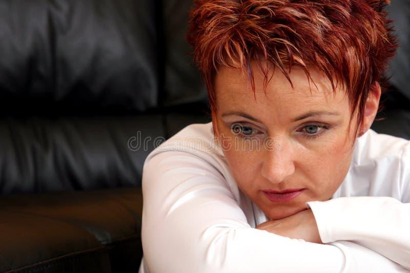 Droevige Redheaded Vrouw royalty-vrije stock afbeeldingen
