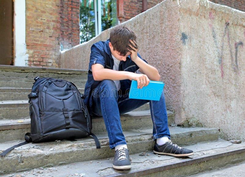 Droevige Student met het Boek stock afbeelding