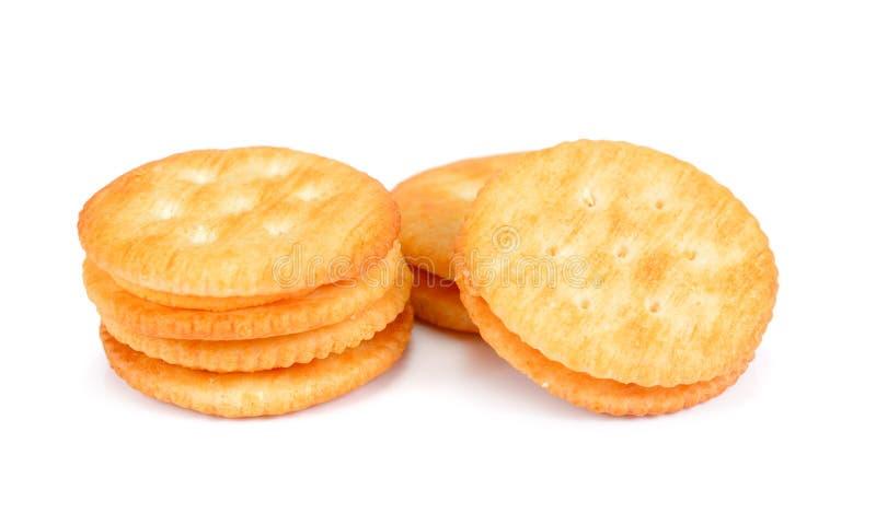 Droge die crackerkoekjes op wit knipsel worden geïsoleerd als achtergrond cracker stock foto