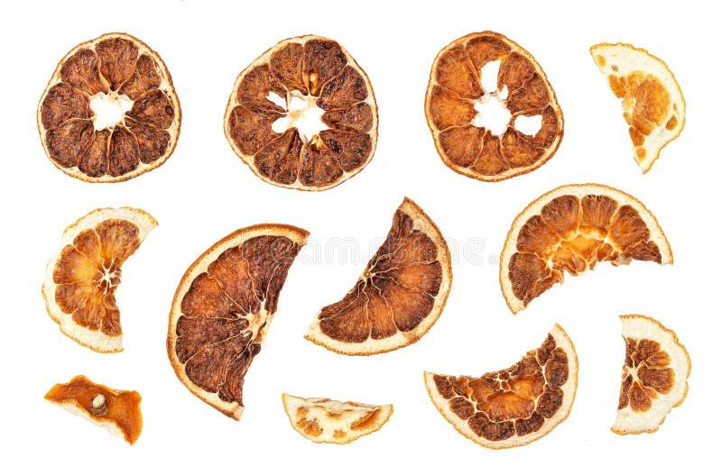 Droge sinaasappelenplakken die op witte achtergrond worden geïsoleerd royalty-vrije stock fotografie
