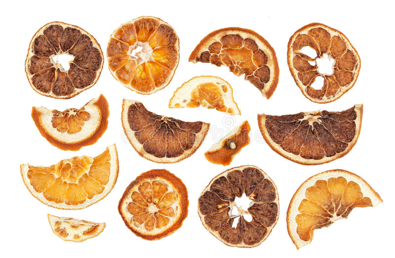 Droge sinaasappelenplakken die op witte achtergrond worden geïsoleerd royalty-vrije stock foto's