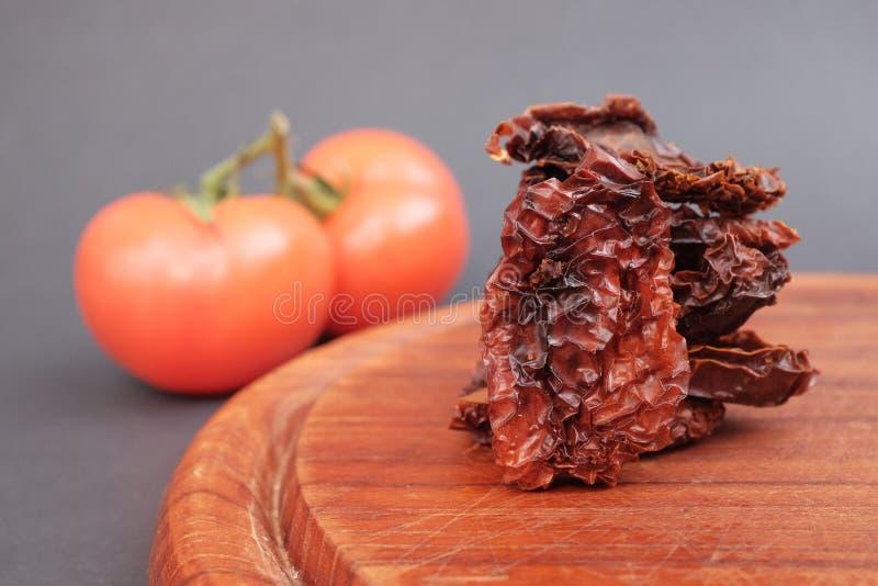 Droge tomaten stock afbeeldingen