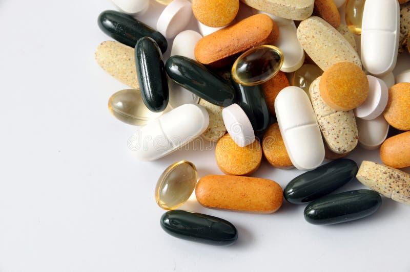 Droghe e vitamine fotografia stock