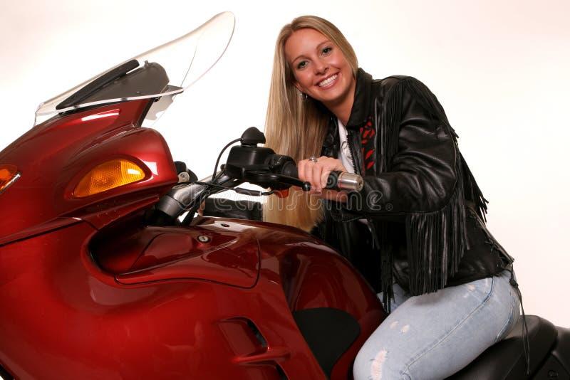 Droit de l'adolescence de moto photographie stock
