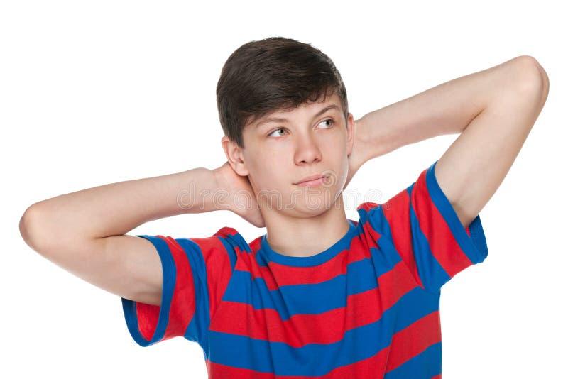 Dromende tienerjongen op het wit stock afbeelding