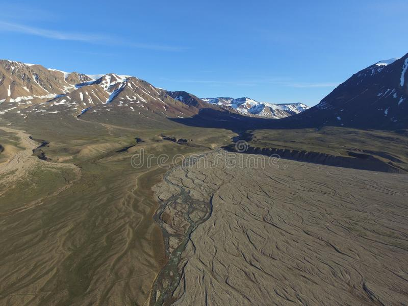Drone aerial image of meltwater streams merging in a fluvial river valley in northeast Greenland royalty free stock photography