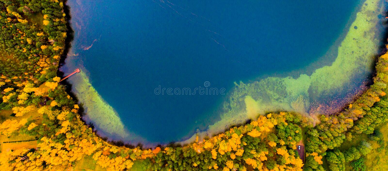 An island of lake Luokesai, aerial. Drone aerial photo of lake in Moletai, Lithuania stock photo