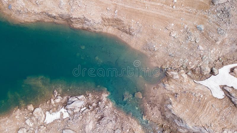 Drone aerial view of the Lake Fregabolgia and the shore. An Alpine artificial lake. Italian Alps. Italy. Mountain landscape royalty free stock images