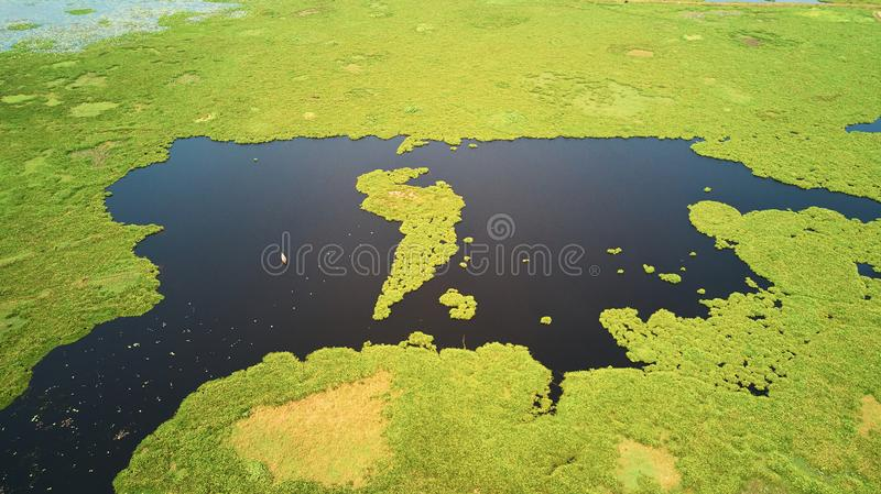 Aerial view of lake in Siem-Reap, Cambodia, with fisherman boat. Drone Aerial view of lake in Siem-Reap, Cambodia, with fisherman boat royalty free stock images