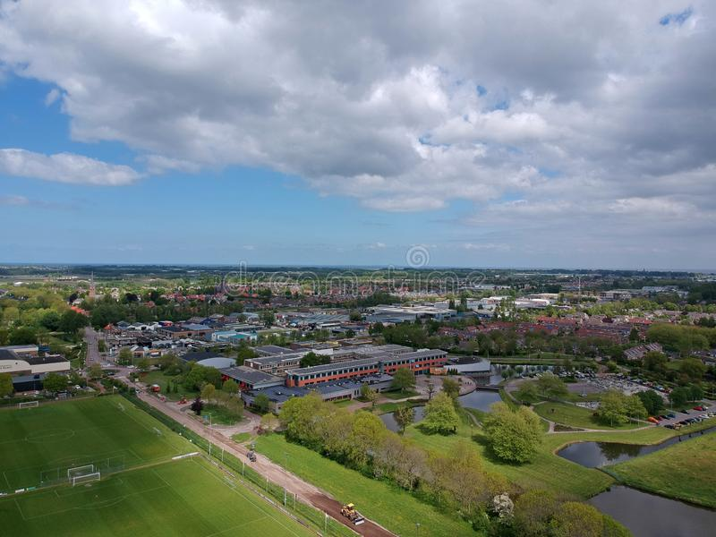 Drone Aerial view taken with a dji spark drone. GROOTEBROEK, THE NETHERLANDS -  10 MEI 2019: Drone Aerial view development of an elongated Dutch village on a royalty free stock photo
