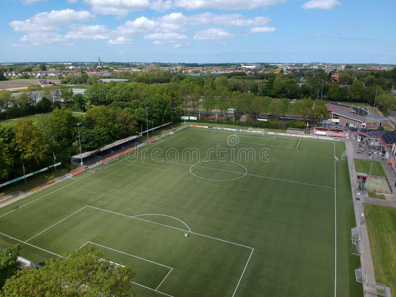 Drone Aerial view taken with a dji spark drone. GROOTEBROEK, THE NETHERLANDS -  10 MEI 2019: Drone Aerial view of a soccer field with billboards all around and stock photo