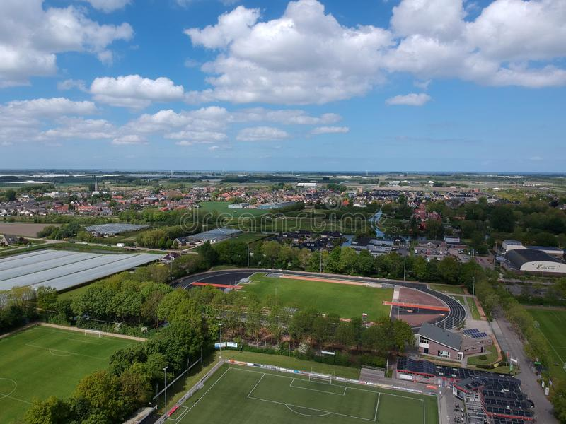 Drone Aerial view taken with a dji spark drone. GROOTEBROEK, THE NETHERLANDS -  10 MEI 2019: Drone Aerial view of a sports complex with soccer fields and a 400 royalty free stock image