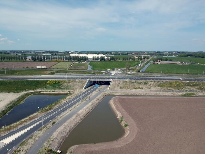 Drone Aerial view taken with a dji spark drone of a higw way. GROOTEBROEK, THE NETHERLANDS - 10 MEI 2019: Drone photo of a busy main traffic road with a concrete stock images
