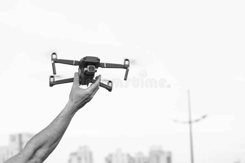 A drone being collected after shooting aerial footage stock photos