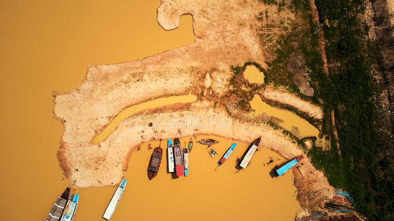 Drone birdeye view Aerial view of boats in Siem-Reap Tonle Sap Cambodia. Drone Aerial view of boats in Siem-Reap Tonle Sap Cambodia royalty free stock photography