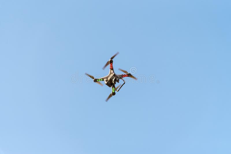 Drone with camera on blue sky. New technology for bird eye view royalty free stock image