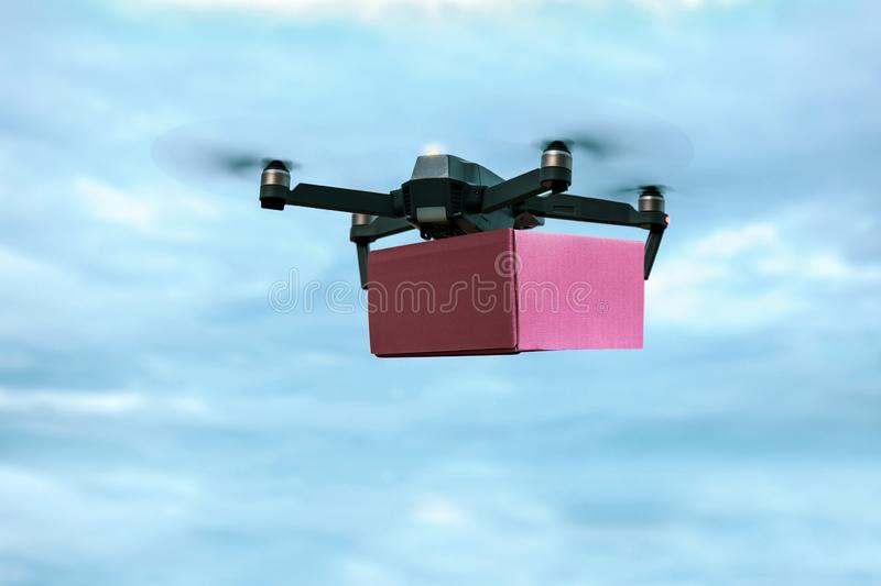 Drone carrying mail box for fast air delivery. royalty free stock images