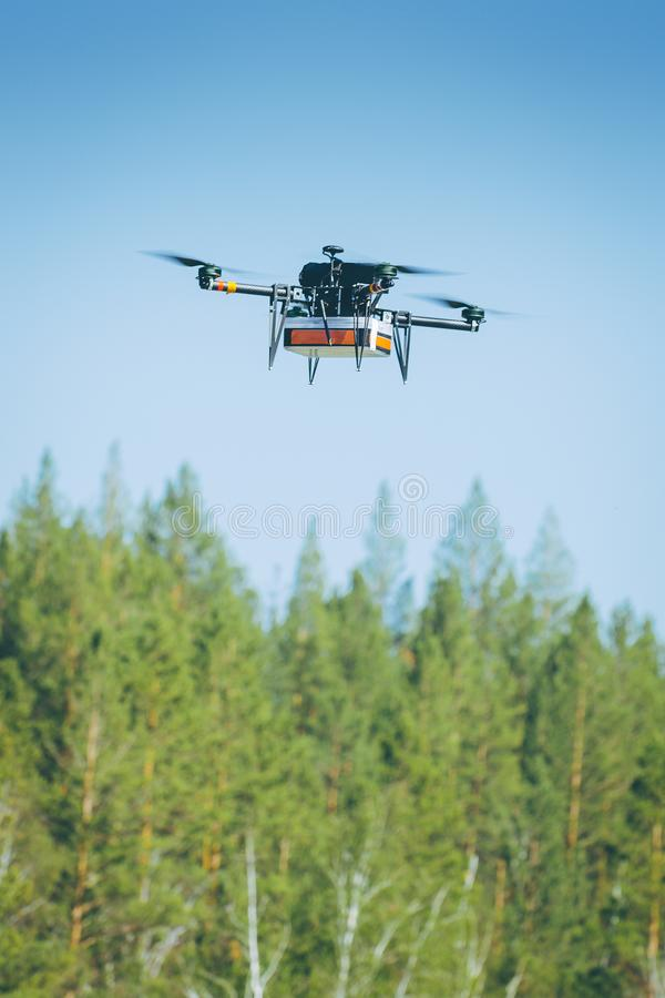 Drone carrying package stock photography
