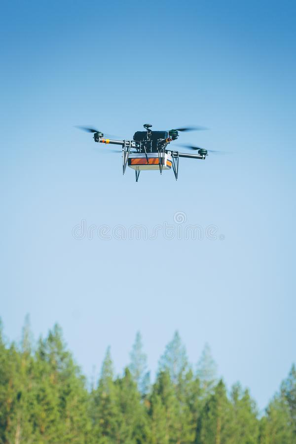 Drone carrying package royalty free stock image