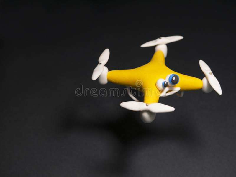 The drone Close up of quadrocopter with the parcel. tired stock photo