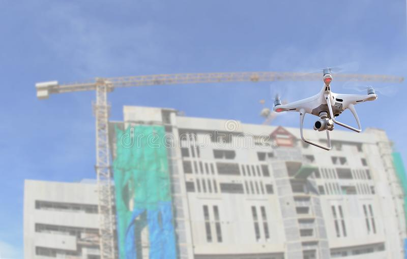drone copter flying with digital camera.Drone with high resolution digital camera over construction site royalty free stock photography
