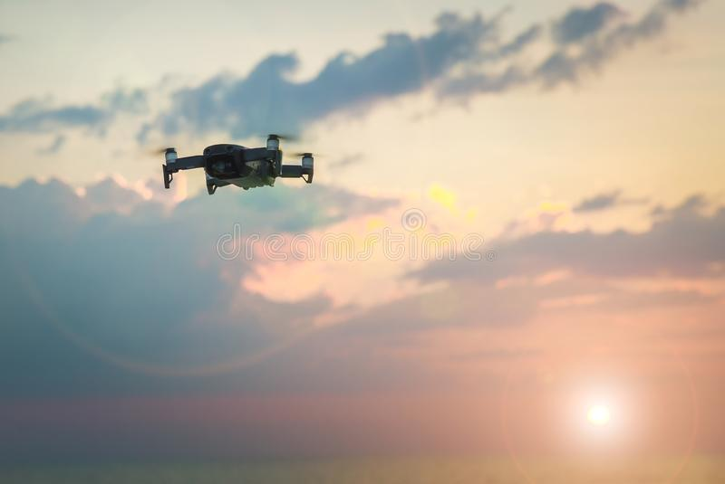 Drone copter flying with digital camera.Drone with high resolution digital camera. Flying camera take a photo and video. royalty free stock photo