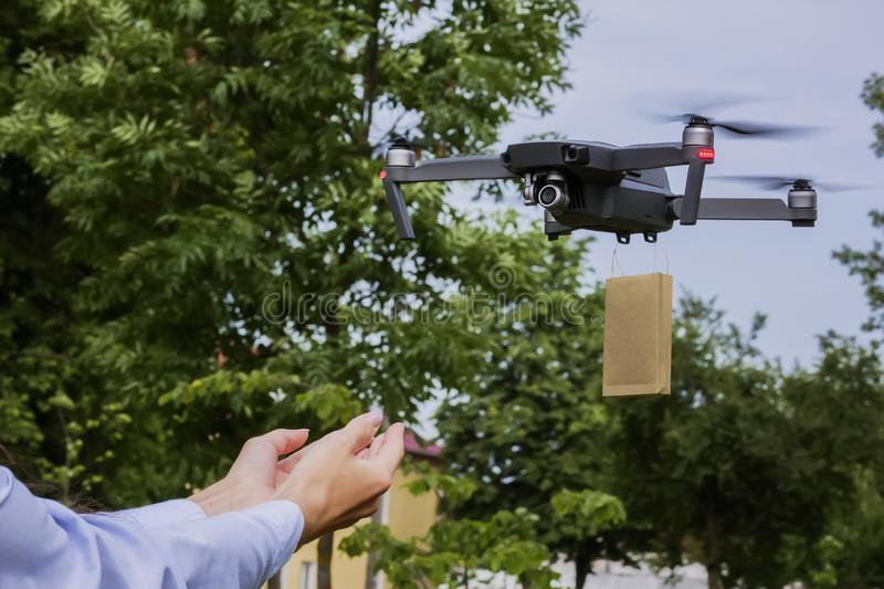 Drone delivered a gift to the girl.  stock photos