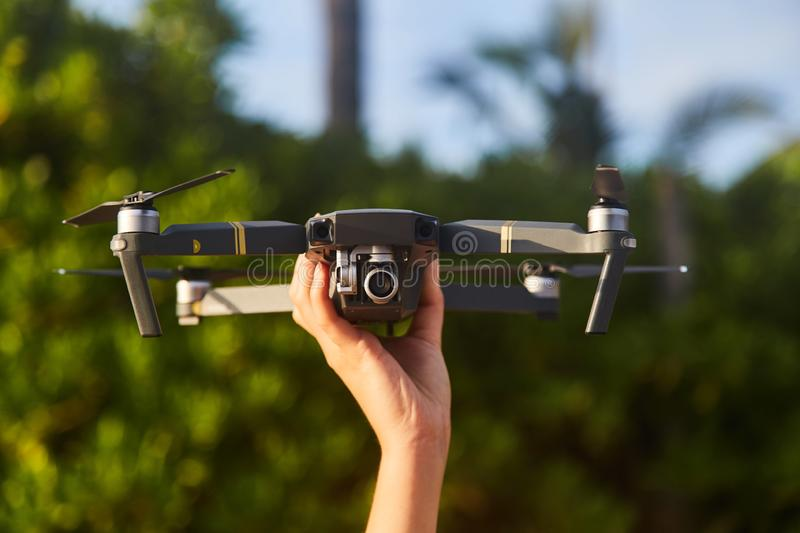 Drone in the female hand. Close-up. Girl launches drone. stock images