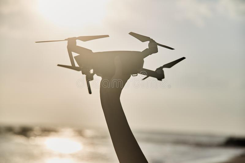 Drone in the female hand. Close-up. Girl launches drone. royalty free stock image
