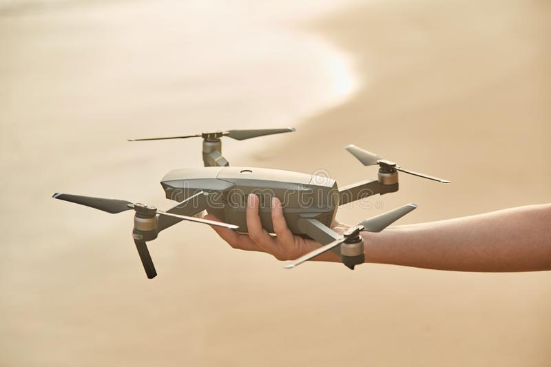 Drone in the female hand. Close-up. Girl launches drone. royalty free stock images