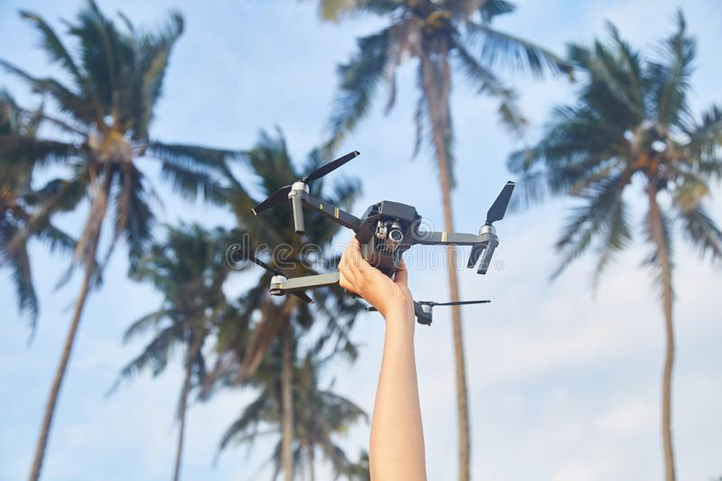 Drone in the female hand. Close-up. Girl launches drone. stock photos