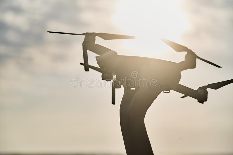 Drone in the female hand. Close-up. Girl launches drone. royalty free stock photos