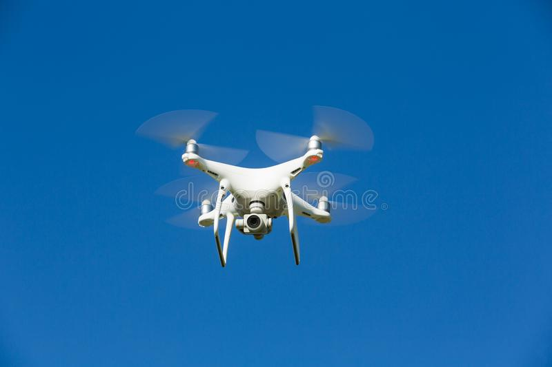 Drone flies in the blue sky royalty free stock images