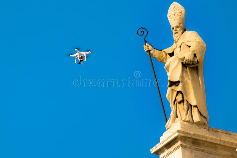 Drone flies in front of a statue of a baroque church in Sicily Italy royalty free stock photos
