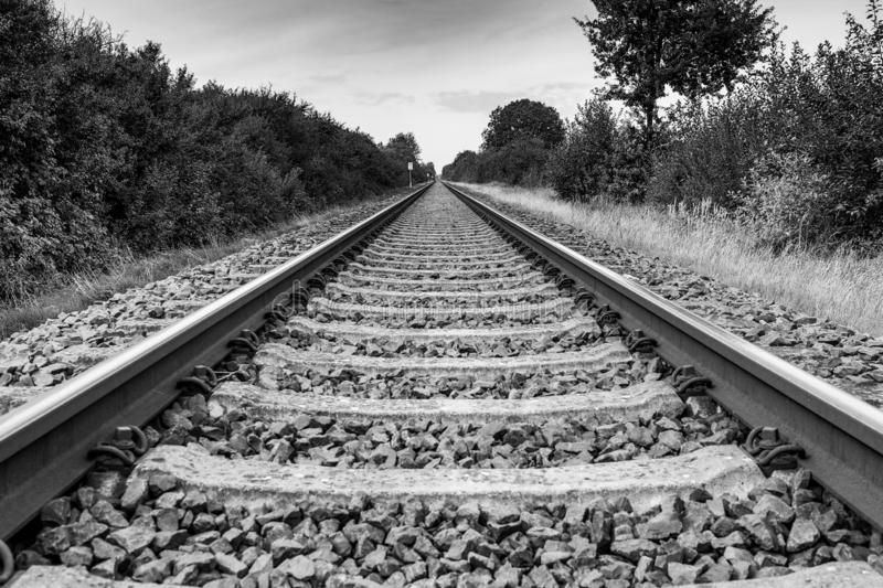 Drone flies in good weather at a very low altitude over railway tracks. A drone flies in good weather at a very low altitude over railway tracks stock photo