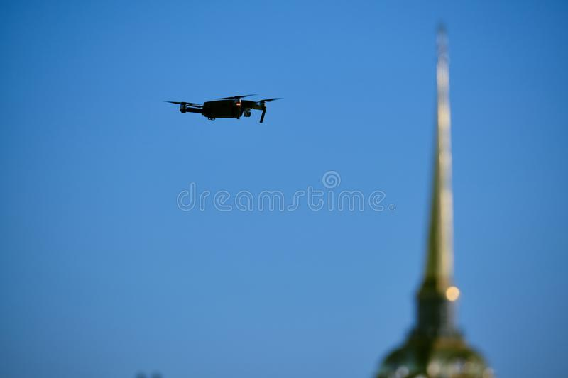 Drone flies over the city center on  background of the sights of St. Petersburg. Photographs and videotaping stock photos