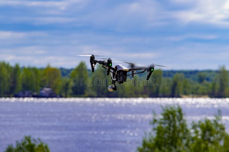 Drone flies over the river and the bank in the vicinity of the city. stock photo