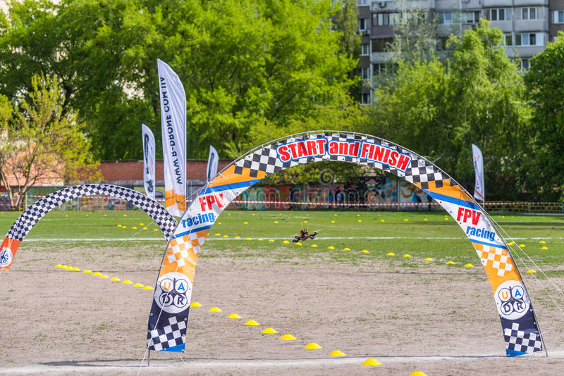 Drone flies through the Racing gates. Kyiv, Ukraine - April 29, 2017: Drone quadrocopter flies through the Racing gates during the Drone Festival in Kyiv stock photography