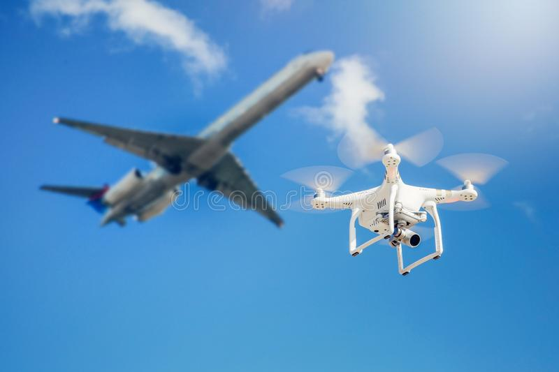 drone fly close to the commercial airplane stock images